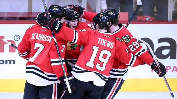 Members of the Chicago Blackhawks celebrate the team's first goal against the Los Angeles Kings Saturday night in Game 5.