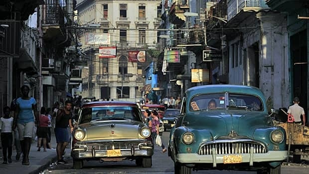 In Cuba, state restrictions have loosened in the past year or so. One result: private cars acting as taxis for tourists and other visitors, like here in downtown Havana.