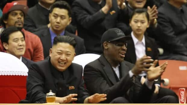 Kim Jong Un, left, and Dennis Rodman enjoy an exhibition basketball game in Pyongyang, North Korea, on Thursday evening.