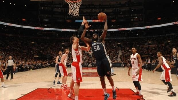 Zach Randolph (50) of the Memphis Grizzlies shoots against Andrea Bargnani (7) of the Toronto Raptors on Wednesday night in Toronto.