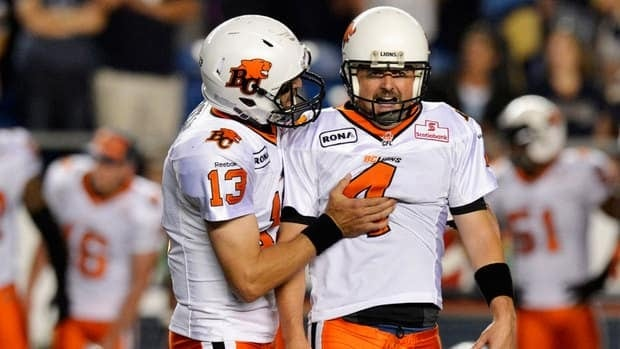 In this Aug. 24 file photo, BC Lions' Paul McCallum, right, celebrates his game-winning field goal against the Winnipeg Blue Bombers with team mate Mike Reilly.