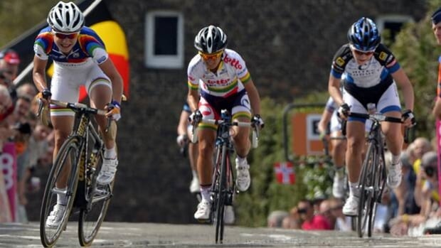 Olympic road race champion Marianne Vos, left, is petitioning to race in the Tour de France.