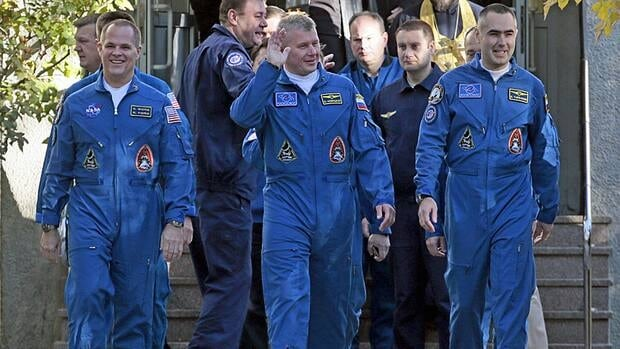 NASA astronaut Kevin Ford, left, and two Russian cosmonauts, Oleg Novitsky, centre, and Yevgeny Tarelkin will return to Earth Thursday night aboard a Soyuz spacecraft.