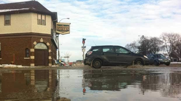 There was more water on Queen Street and Portage Avenue at 4 p.m. Friday, as crews continued fixing a watermain break that flooded the same area Thursday morning.