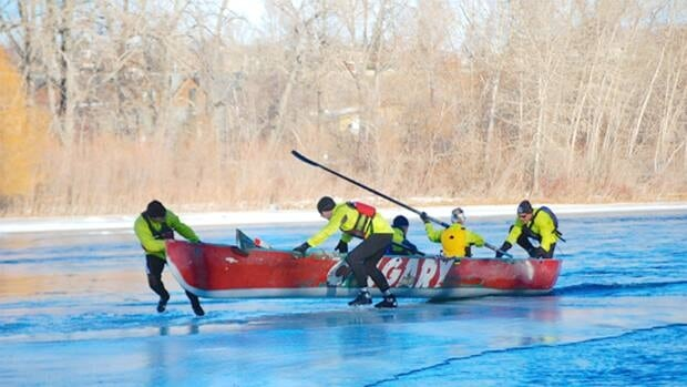 The Calgary Ice Canoe Team practising on the Bow River on Sunday.