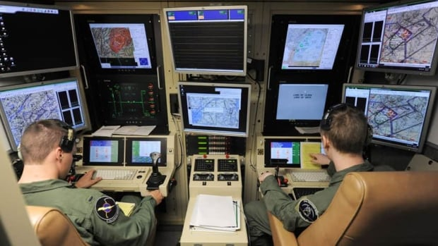 A U.S. Defense Department photo shows a student pilot and sensor operator man the controls of a MQ-9 Reaper. Studies show that video gamers make adept drone operators.