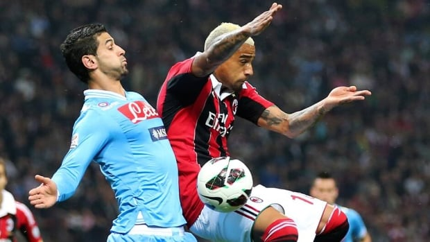 Napoli defender Miguel Angel Britos, left, challenges for the ball with AC Milan midfielder Kevin Prince Boateng, during Sunday's match.