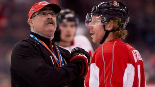 Ottawa Senators head coach Paul MacLean, left, and captain Daniel Alfredsson both won NHL awards on Friday.