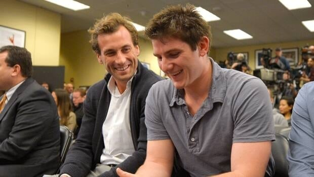 Jarret Stoll, left, and Jonathan Quick of the Los Angeles Kings smile during a news conference to help kick off the club's 2012-13 regular season on Thursday.