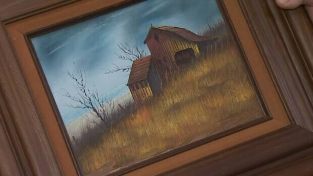 One of the estimated 2,000 items found in the treasure hoard was this painting of a barn by American artist Everett Woodson.