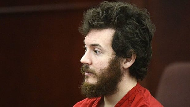 James Holmes sits in the courtroom on March 12, 2013 during his arraignment in Centennial, Colorado.