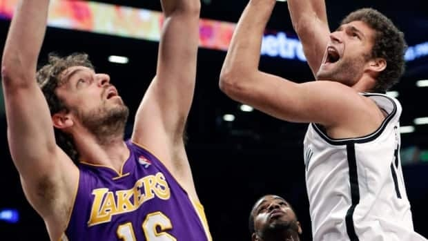 Brooklyn Nets' Brook Lopez, right, shoots over Los Angeles Lakers' Pau Gasol in New York City on Tuesday, Feb. 5, 2013.