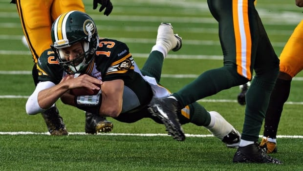 Edmonton Eskimos quarterback Mike Reilly dives for the end-zone for a touchdown during fourth quarter against the Hamilton Ti-Cats in Guelph, Ont. on Sunday. The Esks' offensive line is getting substantial credit for opening holes for Reilly and running back Hugh Charles.