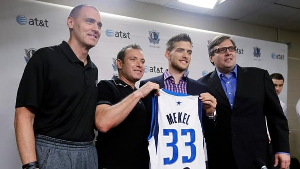 Dallas Mavericks coach Rick Carlisle, left, and general manager Donnie Nelson, right, pose with Alon Mekel, centre left, and his son Gal Mekel, of Israel, after a news conference where the NBA basketball team introduced their rookies in Dallas.