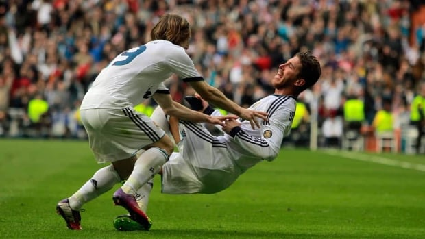 Real Madrid's Sergio Ramos, right, celebrates his goal with Luka Modric from Croatia, left, during a Spanish La Liga soccer match against FC Barcelona at the Santiago Bernabeu stadium in Madrid, Spain, Saturday.