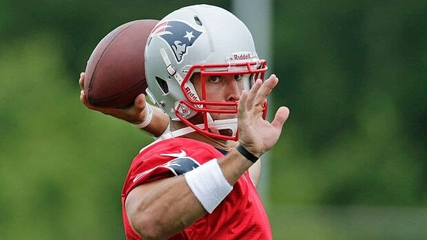 New England Patriots quarterback Tim Tebow throws during his first practice with the team in Foxborough, Mass.