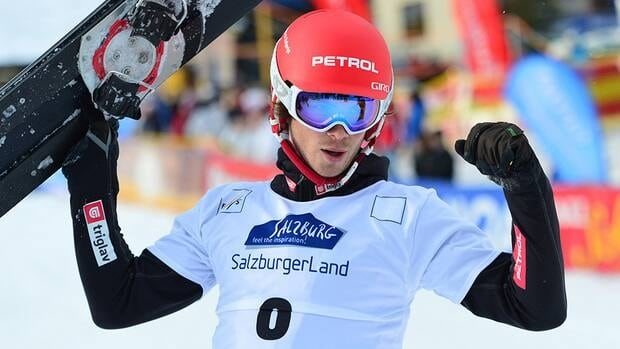 Slovenia's Zan Kosir celebrates his victory after the men's parallel slalom race at the Snowboard World Cup event in Bad Gastein, Austria on Saturday.