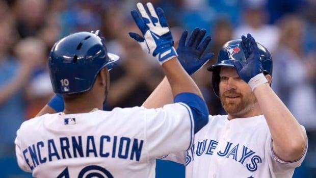 Toronto Blue Jays slugger Edwin Encarncacion, left, and teammate Adam Lind have keyed a recent Blue Jays hot streak.
