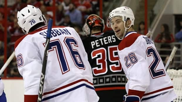 Montreal Canadiens defencemen P.K. Subban, left, and Josh Gorges celebrate a goal in a March 7 road game against Carolina.