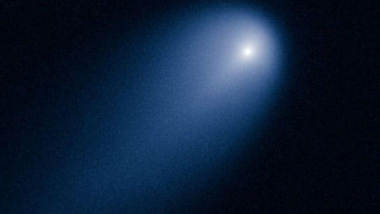 Hubble telescope captures 'comet of the century' | CBC News