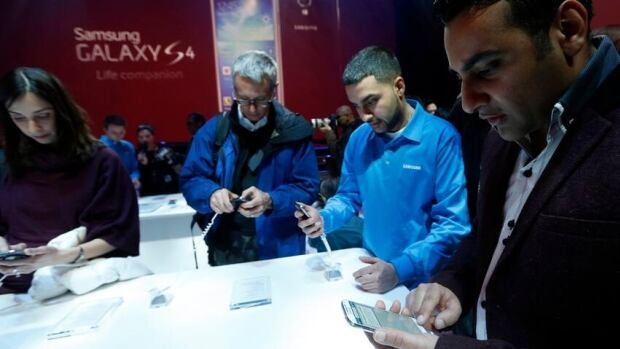 People try out the new Samsung Galaxy S 4 in March. Fongo, a Waterloo-based company has an app for Android and iOS phones that allows people to make calls using data networks. Fongo plans to offer cheap data plans in the $15 range by the end of the year.