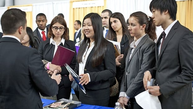 Students listen to a potential employer during the 2012 Big Apple Job and Internship Fair in New York. A U.S. federal court recently ruled unpaid internships violate the country's minimum wage laws.