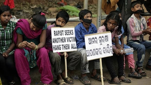 Indian children participate in a protest against child abuse and rising crimes against women, in Bhubaneswar, India, on March 16.