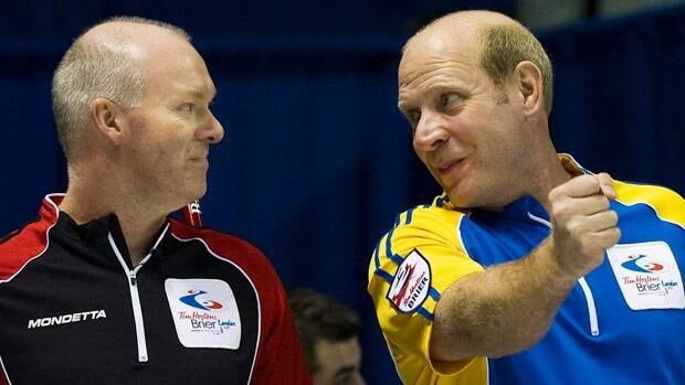 Kevin Martin, right, and longtime rival Glenn Howard, will get a chance to join forces under the Continental Cup format.