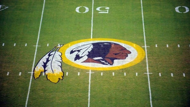 In this Aug. 28, 2009, file photo, the Washington Redskins logo is displayed at midfield before the start of a preseason NFL football game in Landover, Md. The team's nickname, which some consider a derogatory term for Native Americans, has faced a barrage of criticism.