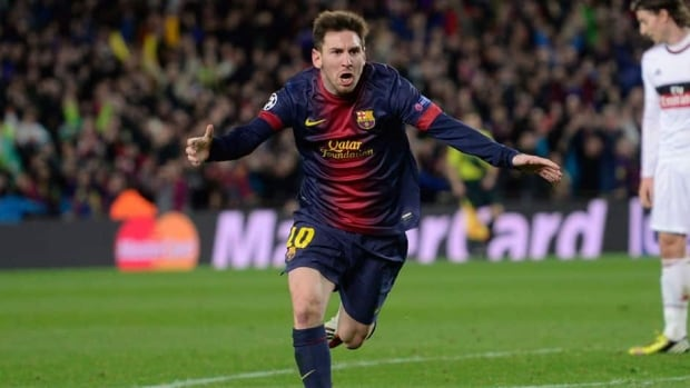 Barcelona forward Lionel Messi celebrates after scoring a second goal during the Champions League round of 16 second leg soccer match between FC Barcelona and AC Milan.
