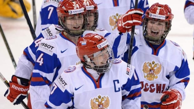 Team Russia's captain Yekaterina Smolentseva, front, is given a cheer from teammates after defeating Team Switzerland 2-1 in their quarterfinal match at the IIHF Women's World Hockey Championship in Ottawa on Saturday. Next up for the Russians are Team Canada in the semis.