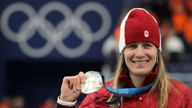 Canada's Kristina Groves, shown here celebrating her silver medal-performance after the 1,500 metere speed skating race at the Vancouver 2010 Olympics, says it's important to enter a race with an edge.