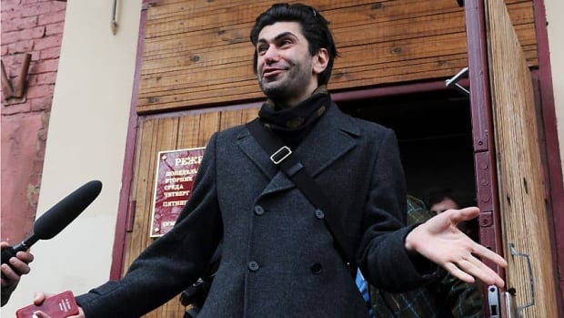 Star Bolshoi principal dancer Nikolai Tsiskaridze talks to media outside a Moscow court in April, when he filed a complaint over alleged unfair treatment by his employer.