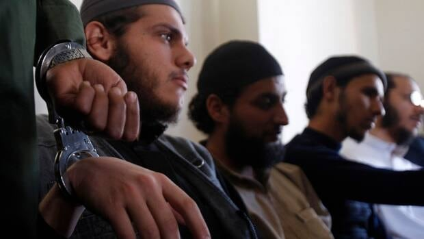 Suspected al-Qaeda militants are handcuffed as they attend a court in Sanaa, Yemen, on Monday. A U.S. drone strike east of the capital killed two suspected militants from the group.
