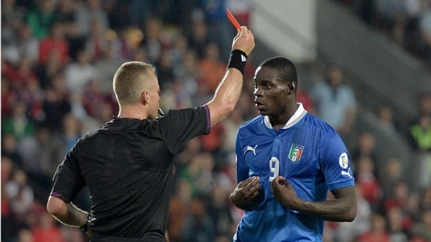 Italy's Mario Balotelli, right, receives the red card from referee Svein Oddvar Moen during Friday's World Cup Group B qualifying soccer match against the Czech Republic.