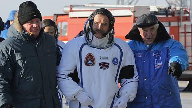 Canadian astronaut Chris Hadfield (centre) walks to a Soyuz-FG rocket in Kazakhstan on Dec. 19, 2012.