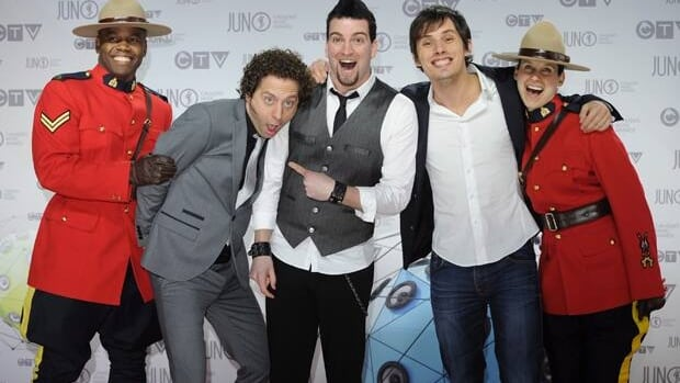 Members of Vancouver's Marianas Trench joke around with RCMP officers as they pose for photographers on the red carpet at the 2012 Juno Awards in Ottawa.