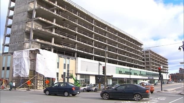 An abandoned building near Montreal's bus terminal will be converted into a new housing complex.