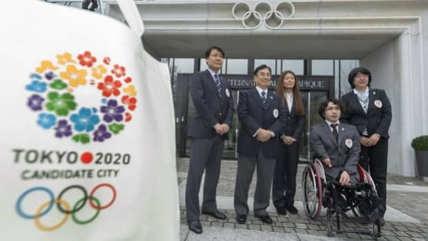Key members of the Tokyo delegation pose for photographers outside IOC headquarters in Lausanne, Switzerland, on Jan. 7.