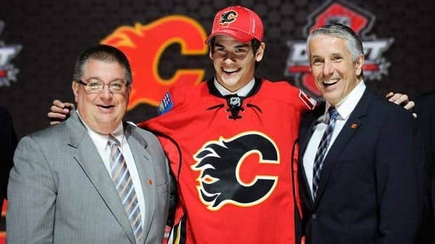 Sean Monahan stands with Gm Jay FEaster, left, and coach Bob Hartley after being taken sixth overall on Sunday.