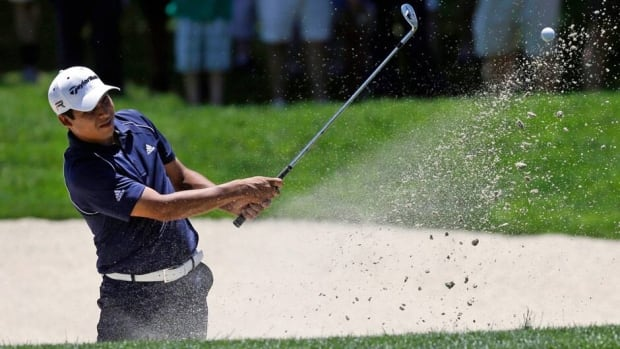 Andres Romero chips onto the first green from a bunker during the third round of the AT&T National at Congressional Country Club on Saturday in Bethesda, Md.