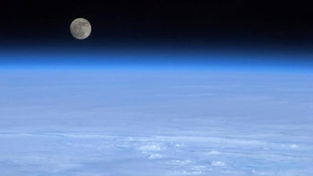 The mooon hovers above Earth is this picture from Col. Chris Hadfield of the Canadian Space Agency.
