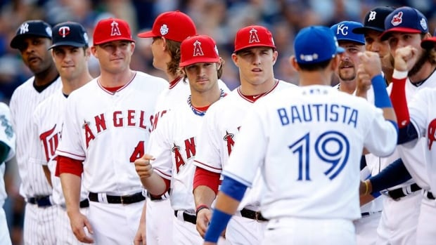 Toronto Blue Jays outfielder Jose Bautista is seen here greeting fellow American League teammates before the 2012 All-Star Game in Kansas City. Bautista has been named an all-star starter once again and took to Twitter to thank his fans.