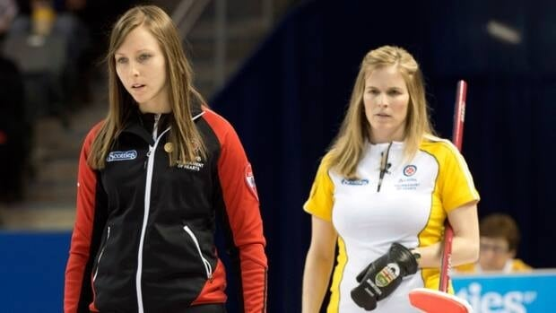 Ontario skip Rachel Homan, left, and Manitoba skip Jennifer Jones look over a shot during their 1-2 page playoff game at the Scotties Tournament of Hearts on Saturday night in Kingston, Ont.