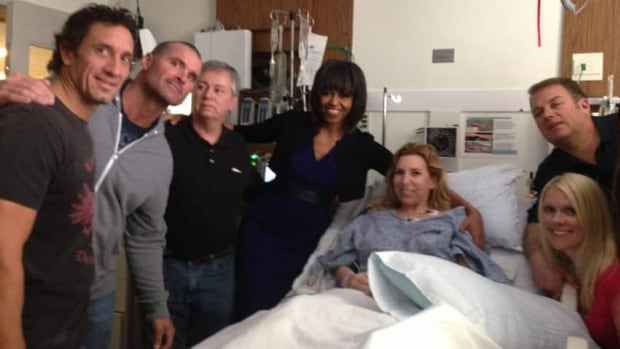 Heather Abbott, in the hospital bed, is shown during a visit from Michelle Obama earlier this month. She said she's given no thought to the alleged attackers and focused strictly on her recovery.
