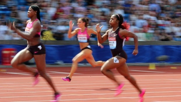 Blessing Okagbare of Nigeria, left, races to victory in the women's 200 metres at the IAAF Diamond League on Sunday in Birmingham, England.