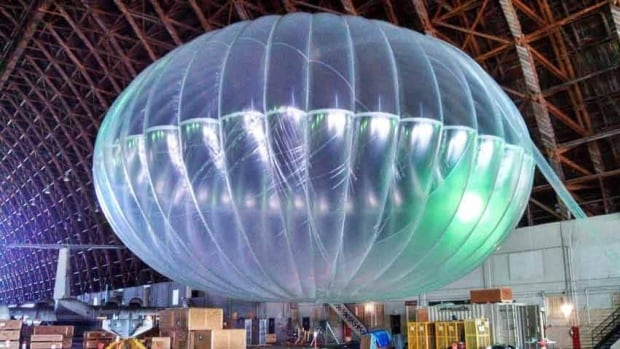 A fully inflated test balloon sits in a hangar in California. Google is testing the balloons which sail in the stratosphere and beam the internet to Earth.