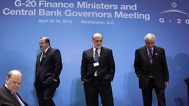 Gathering for 'the family photo' at the G20 meeting in Washington. Seen (L-R) are Irish Finance Minister Michael Noonan, Brazil's central bank governor Alexandre Tombini, U.S. Federal Reserve chairman Ben Bernanke and Saudi Arabia's Minister of Finance Ibrahim Al-Assaf.
