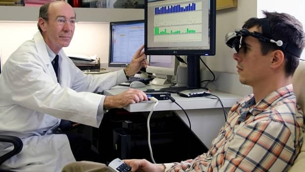Robert Hess, left, director of the opthalmalogy research department at McGill University, led the study. It involved getting people with lazy eye to play a video game using goggles that presented only part of the image to each eye and required the use of both eyes to play.