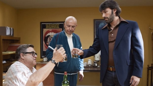A scene from Argo with John Goodman, left, Alan Arkin, center, and actor-director Ben Affleck, is up for a best picture Oscar.